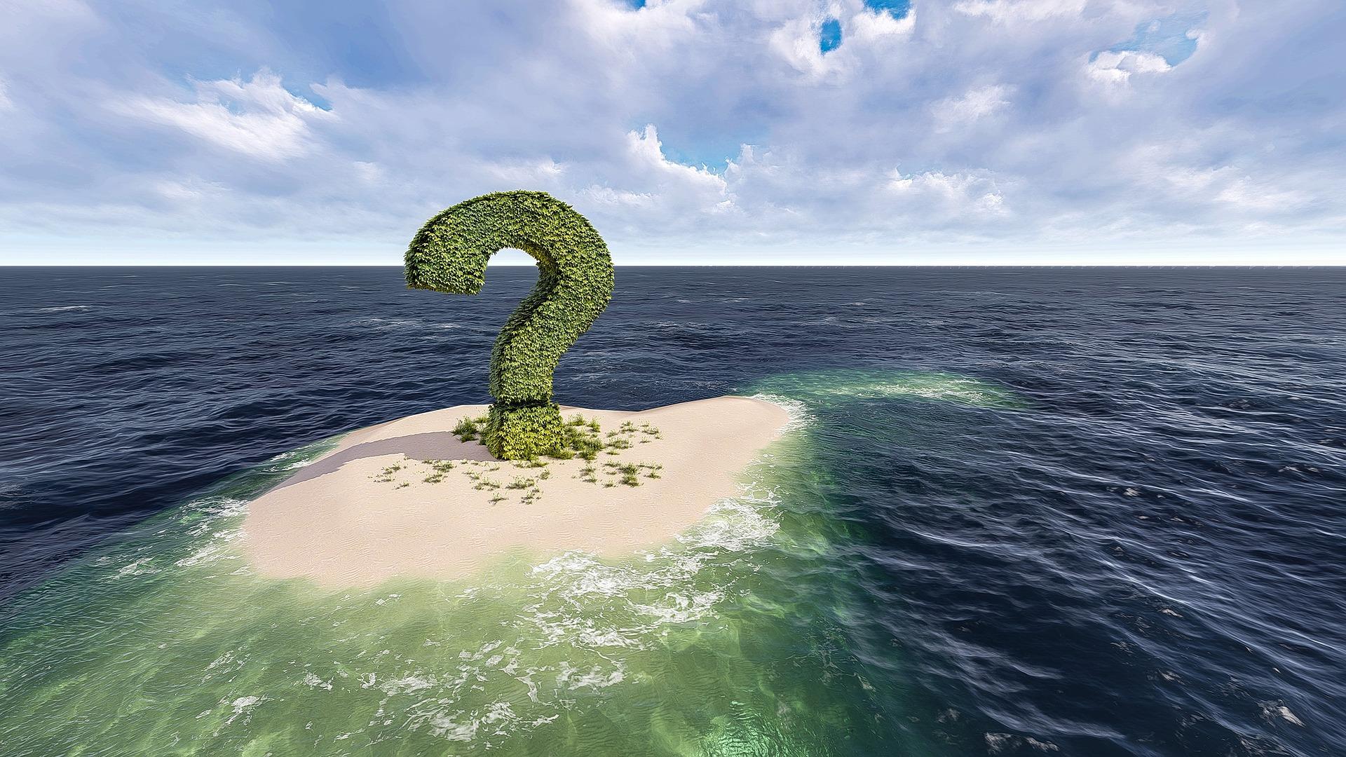 Grünes Fragezeichen aus Blättern auf einer Insel